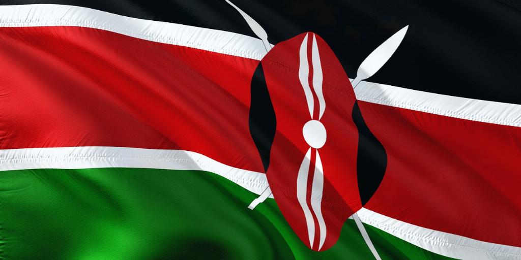 kenya flag blowing in wind against blue sky